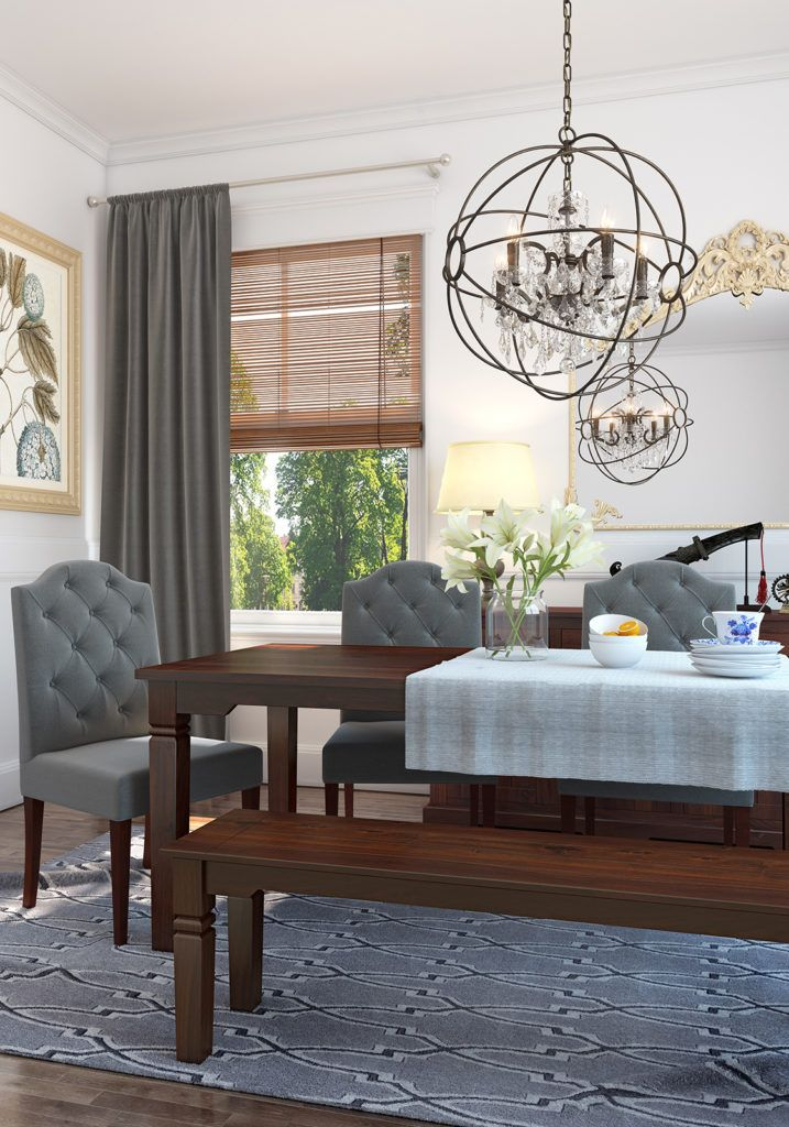 Elgegant dining arrangement with a colonial style bench