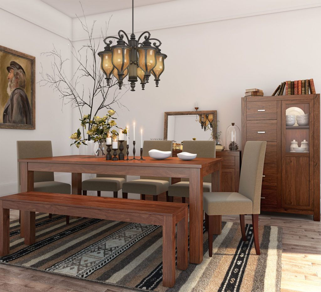 Contemporary dining table paired with matching bench and upholstered chairs
