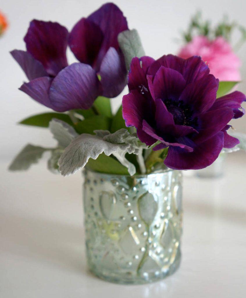 poppy flower arrangements in metallic vase