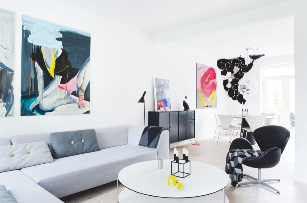A great way to pick art for your walls is to unite pieces with the room through a theme.