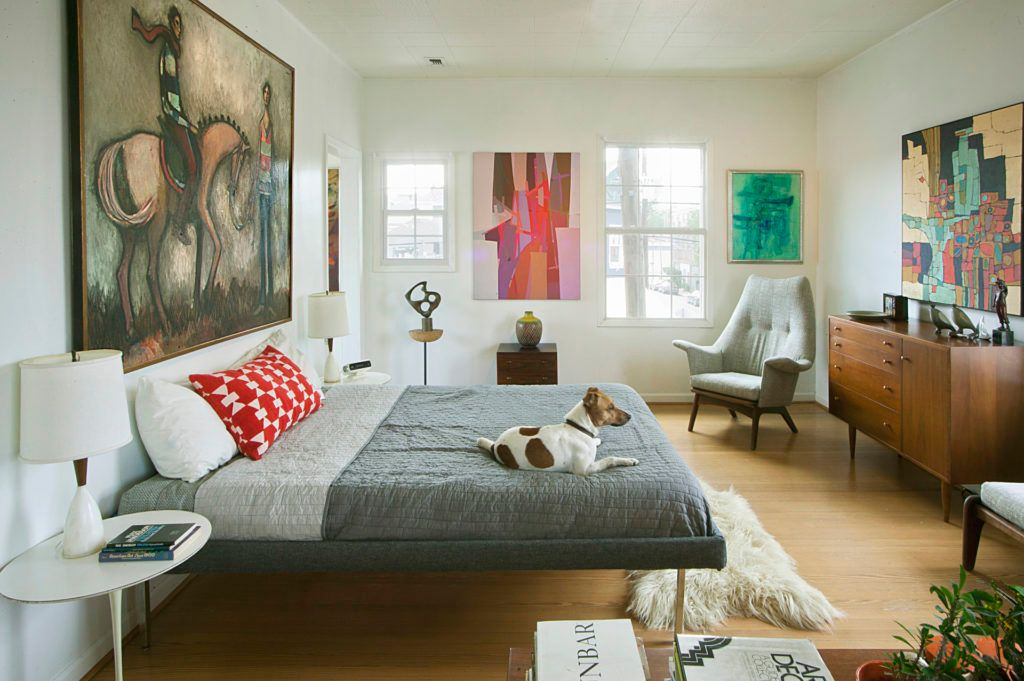 Don't be shy to mix and match when you pick art for your walls.