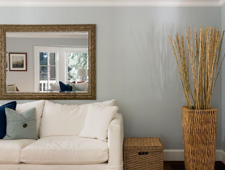 decorative mirror behind sofa
