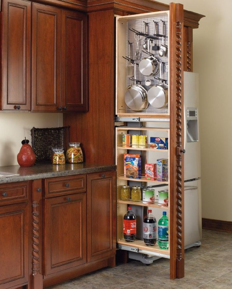 Pull-out pantry in kitchen to store kitchen staples