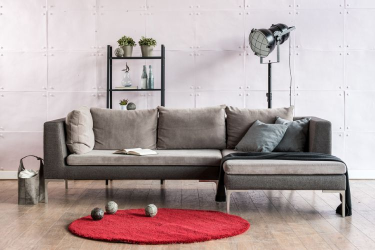 A ladder shelf or floating shelves are a great way to occupy the space behind your sofa.