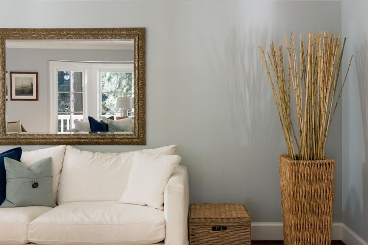 Rest a large mirror to fill up that awkward space behind your sofa.