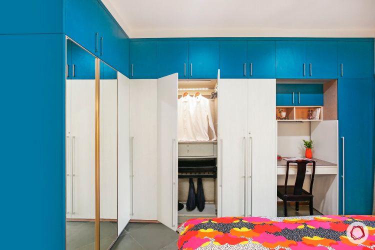 home interiors at Kengeri villa-blue and white wardrobe-morrored shutter