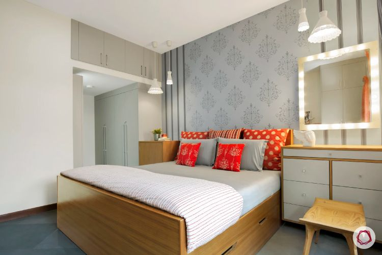 home interiors at Kengeri villa-soothing bedroom-grey wallpaper-white wardrobe-drawers-mirror