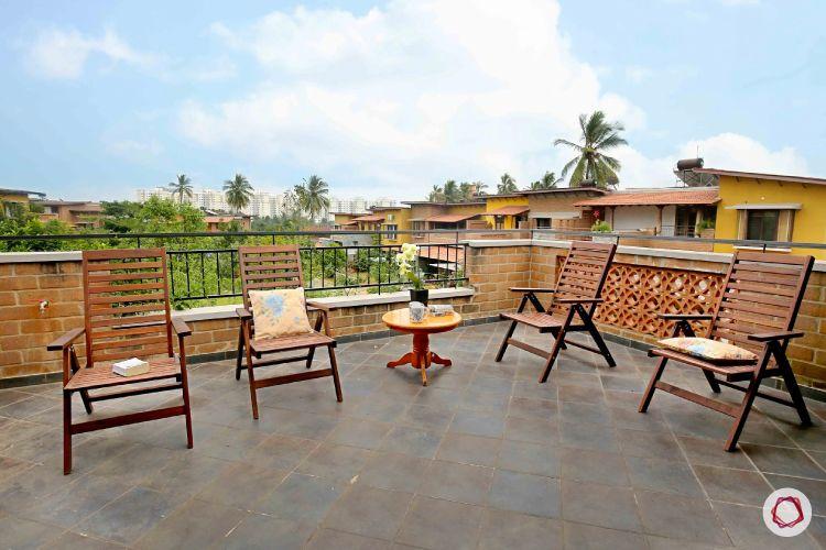 home interiors at Kengeri villa-balcony-mangalorean tiles-countryside seating