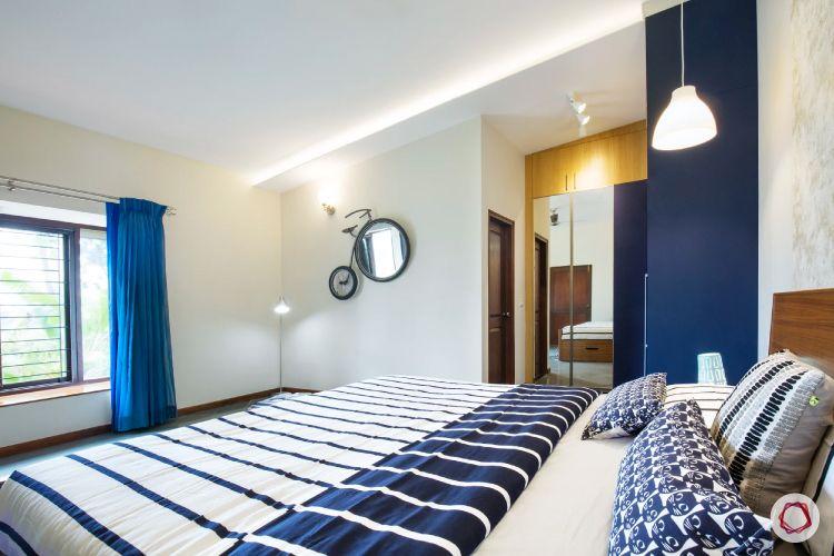 home interiors at Kengeri villa-blue bedroom-quirky mirror-mirrored wardrobe