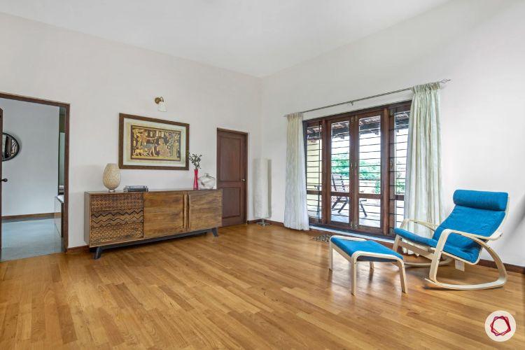 home interiors at Kengeri villa-wooden flooring-drawers-recliner-footstool