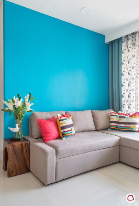 Goregaon home design-blue wall-neutral sofa