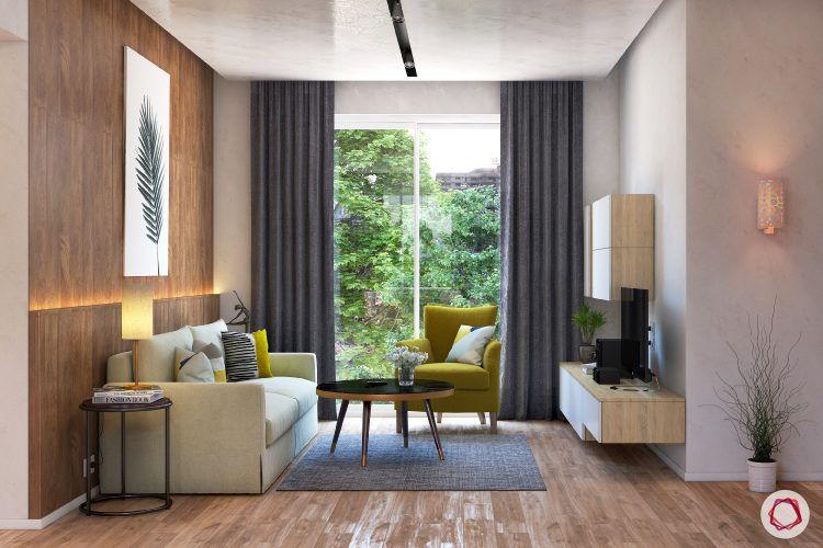 kangana ranaut manali home-accent chair-wooden flooring-wall art-wall panelling