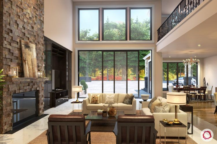 kangana ranaut manali home-exposed brick fireplace-neutral living room-wooden furniture-chandelier
