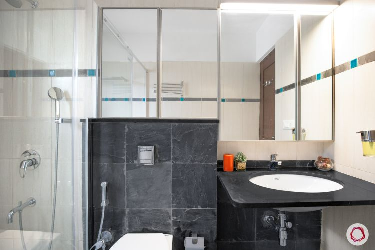 shower-cubicle-mirror-cabinets-black-countertop-sink