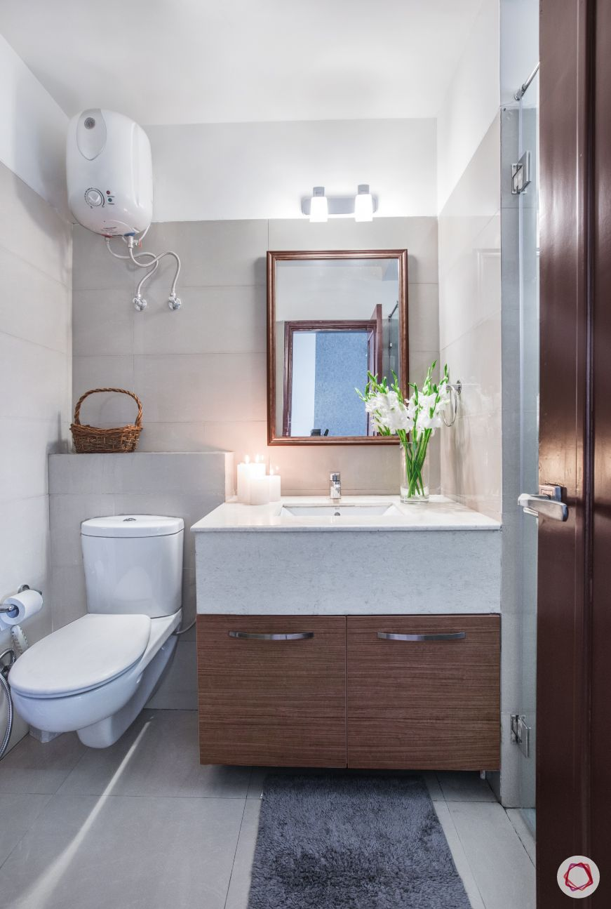 white-wall-tiles-sink-flower-rectangle-mirror-loo-toilet-storage-cabinet