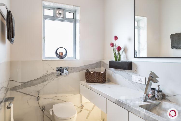 minimal-white-marble-toilet-sink-flowers-mirror