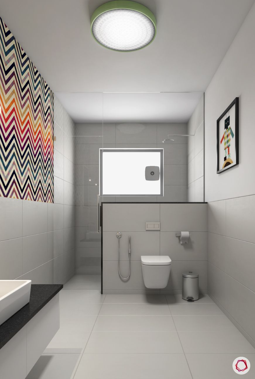bathroom-white-toilet-wall-patterned-tiles-sink