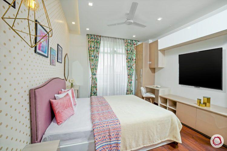 best interior design-daughter's bedroom-salmon pink headboard-study cum tv unit-wall mount storage