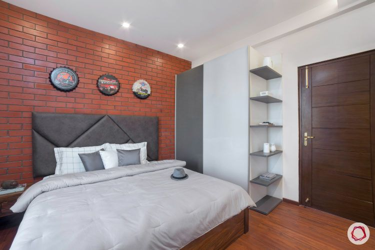 industrial bedroom-grey display shelves-exposed brick wall