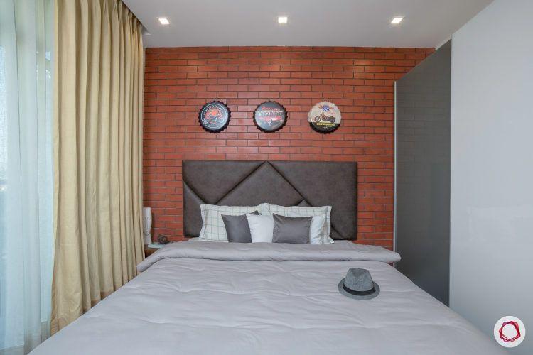 best interior design-industrial bedroom-exposed brick wall