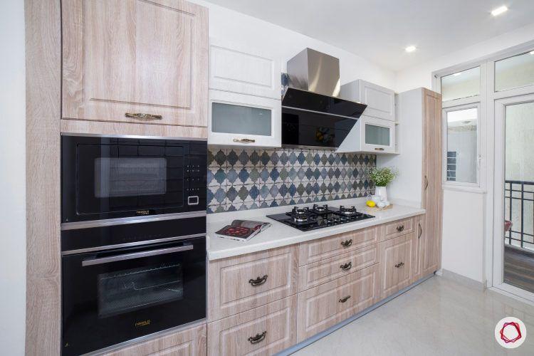 best interior design-white wall cabinet-wooden base cabinet-geometric backsplash