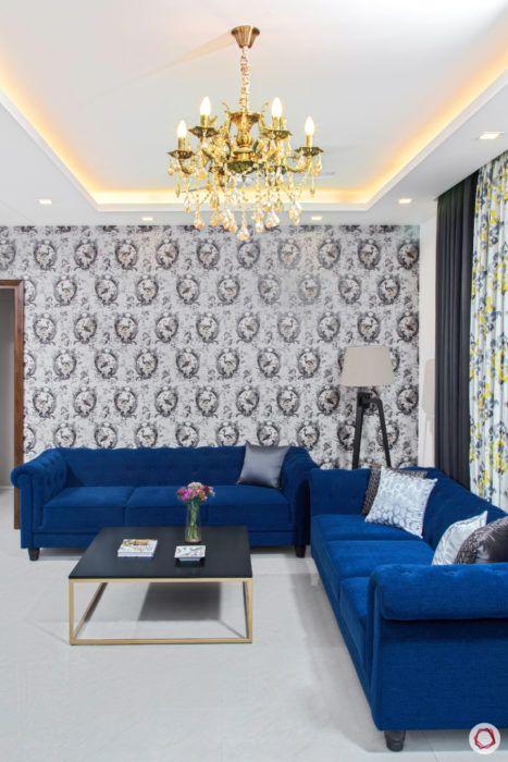 best interior design-blue chesterfield sofa-flamingo print wallpaper