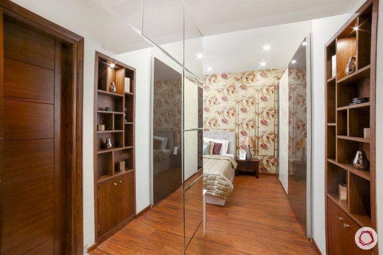 best interior designbest interior design-floral wallpaper-table lamp-side table-display shelf-wooden