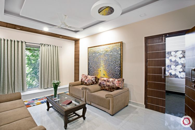 House interior-sofa-coffee table-painting-window