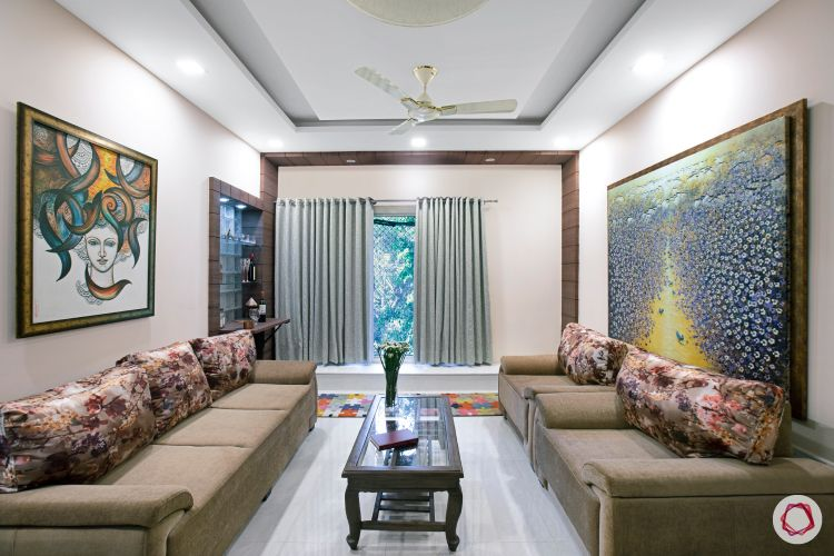 House interior-living room-paintings-sofa-curtains
