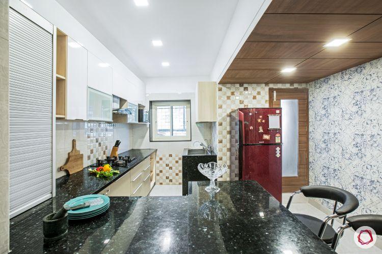 House interior-modular kitchen-tiled breakfast-roller shutter unit-countertop
