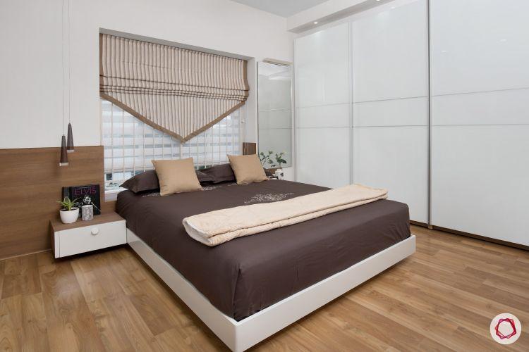blinds-v-shaped-blind-wooden-flooring-white-wardrobe-bedroom