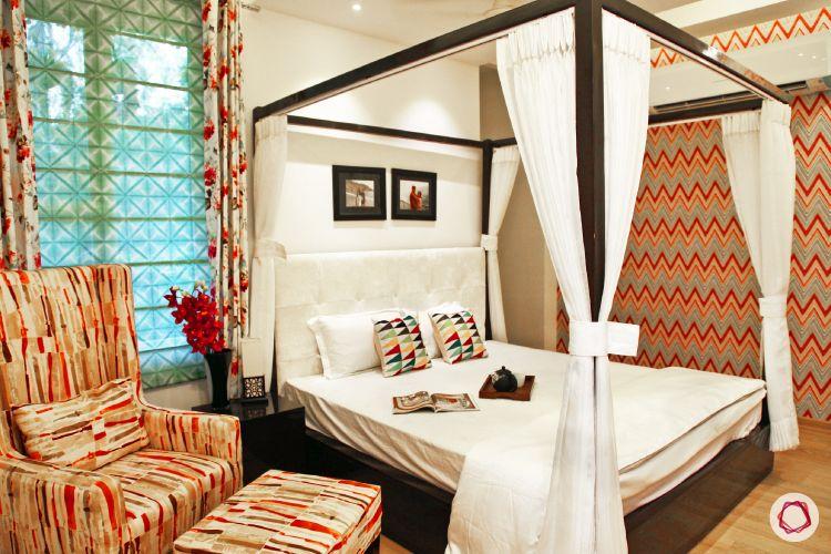 blinds-bedroom-four-poster-black-floral-pattern-armchair-footstool