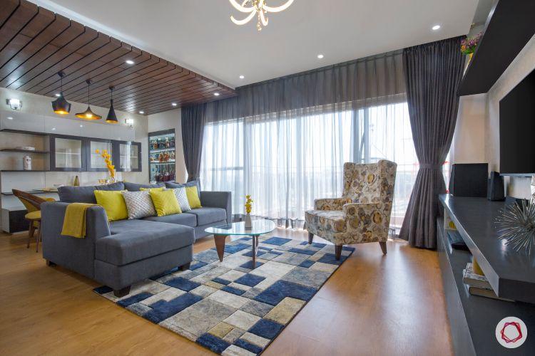 blinds-floor-to-ceiling-living-room-sofas-armchair-rug-wooden-flooring