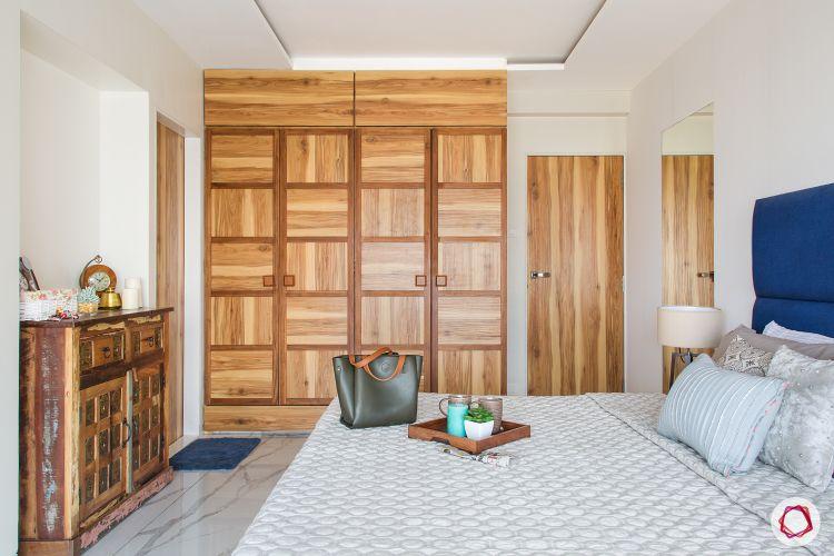 bedroom-wood-wardrobe-cabinet-bed-blue-headboard