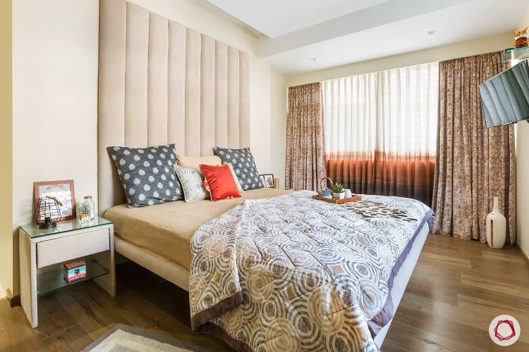 bedroom-fabric-headboard-side-table-wooden-flooring-vase