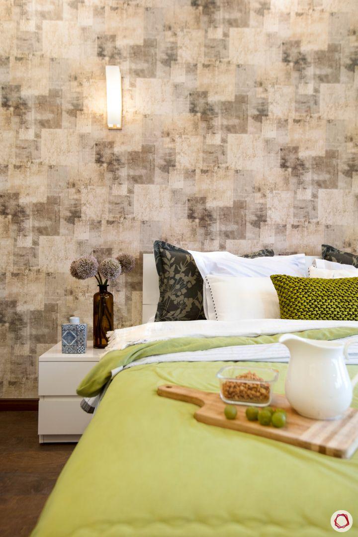 Room-design-wall lights-green bedding-bedside table