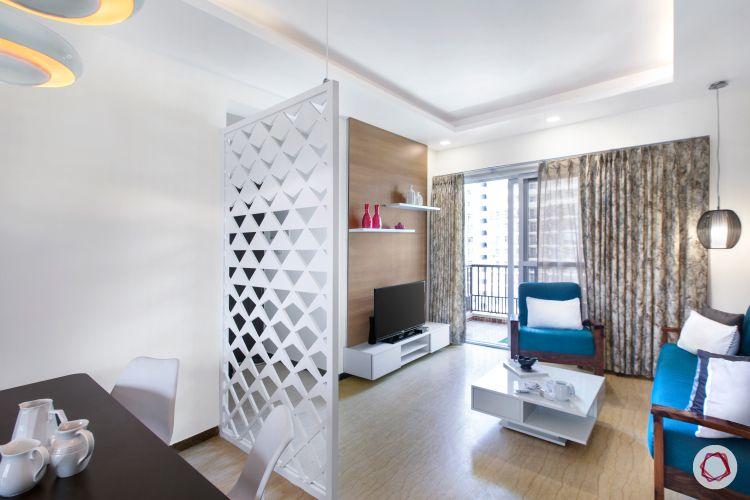 blue sofa design-pendant lighting-tv unit-white partition