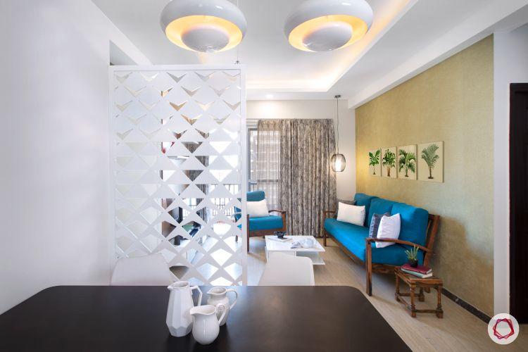 blue sofa-white jaali partition-lighting