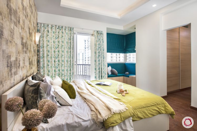 Room-design-blue bay seating window-green bedding-floral curtains
