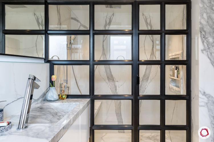 Bathroom-glass partition-marble tiles-sleek