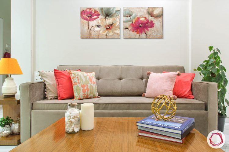 Alia bhatt-living room-interiors-grey sofa-wooden table-pink cushions