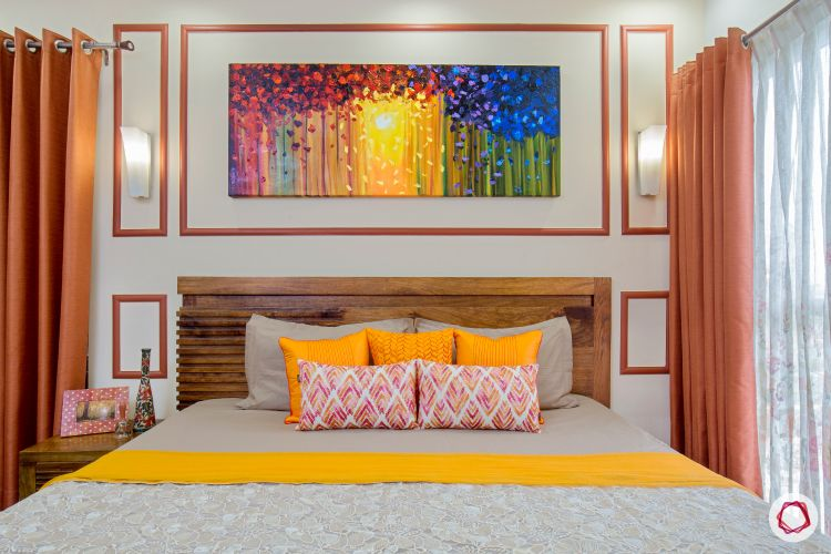 top interior designer master bedroom accent wall with bronze orange trims