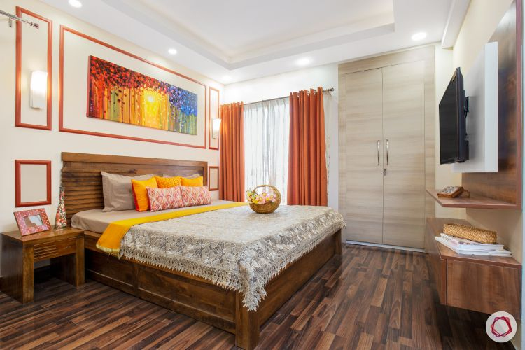 top interior designer master bedroom featuring trims, wooden tones and colourful furnishings