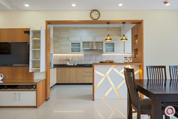 interior open kitchen with breakfast counter, pendant lights and all wood framework