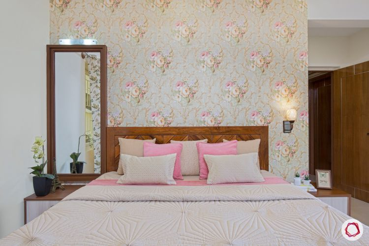 interior floral wallpaper and wooden headboard