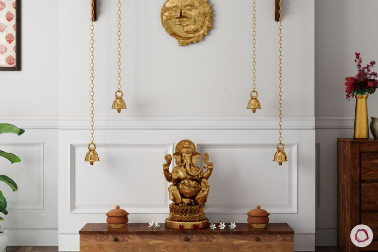Home temple-idol against a wall-ganesha idol-handing lamps