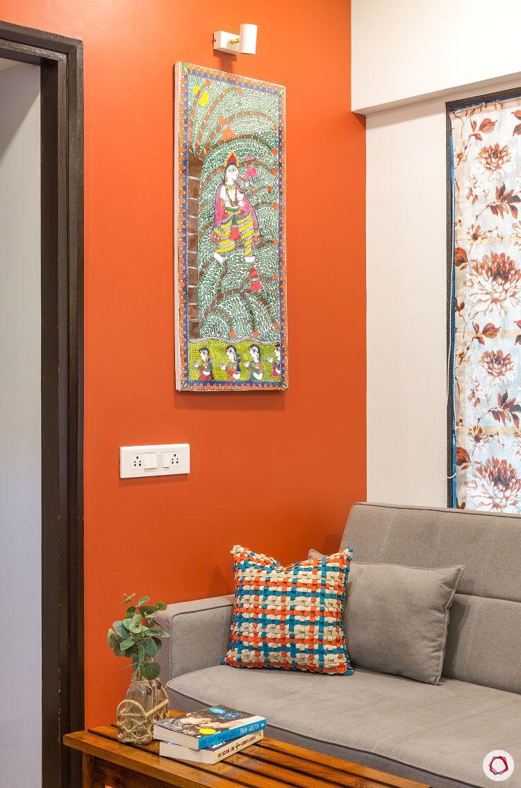 Studio apartments_rust wall living room