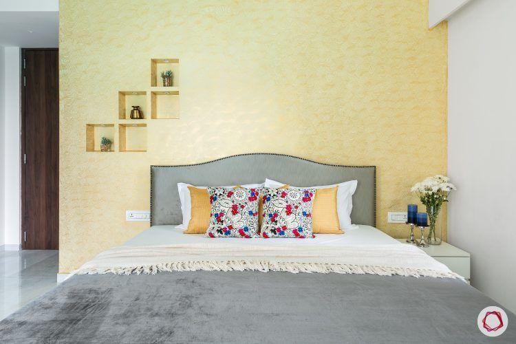 3bhk-house-plan-master-bedroom-grey-headboard