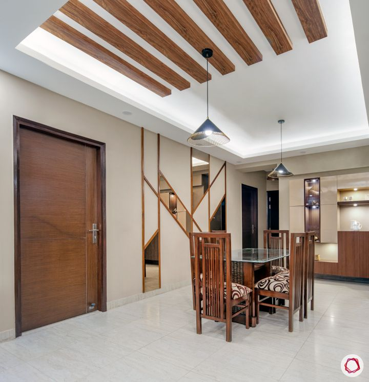 3bhk flat_dining room-wooden-rafters-chairs-mirror-panel