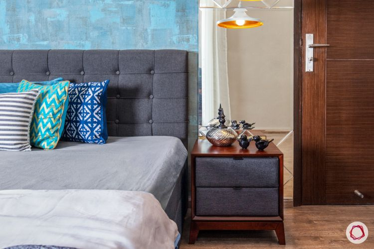 master-bedroom-blue-wall-mirror-panel-light-fixture-bed-sidetable